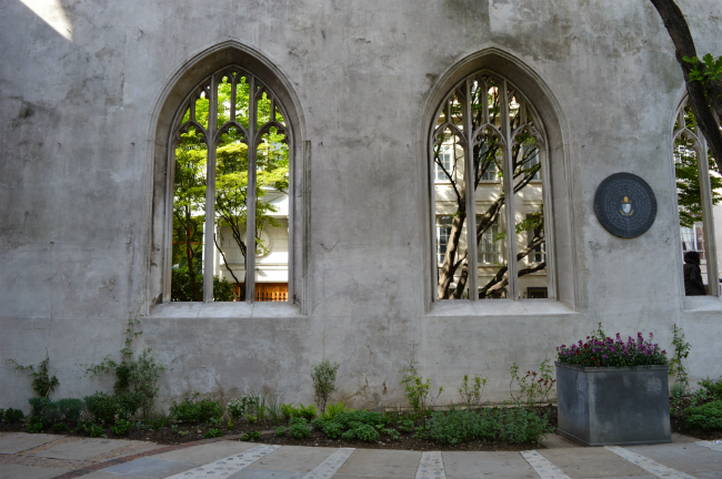 Wall and flower at St Dunstan in the East, London