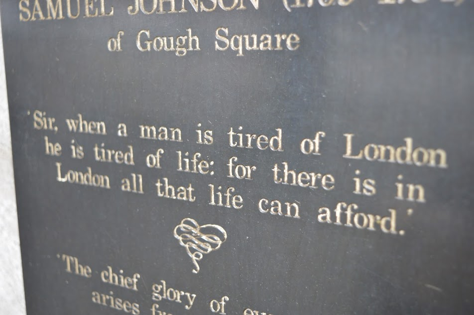 'Tired of London' Samual Johnson quote on a plinth outside Dr Johnson's House in London, UK